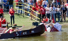 Stony Brook University students raced across Roth Pond for the annual Roth Regatta on Friday, April 26, 2013. Mark Faerchuk, a freshman at Stony Brook, did not make it across the pond. His team lost to the S.S. Fredum, left, made by Wagner College. Faerchuk's boat, like many others, sank early on. Photo by Alexa Gorman