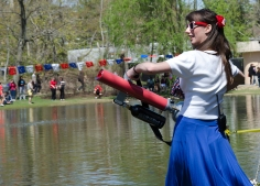 Stony Brook University's Undergraduate Student Government President, Anna Lubitz, shot t-shirts from a t-shirt cannon during the annual Roth Regatta. Every spring, students race boats made of cardboard and duct tape across the pond. Photo by Alexa Gorman
