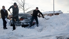 (From left) Brett Heller, Andrew Haber and Matthew Lyons dug out a friend's car for over two hours on Sunday, February 10, 2013, after Winter Storm Nemo hit Stony Brook University. The boys said the conditions left by plows made it more difficult to dig out the car since the plowed parking lot compacted the snow in at least a three foot pile behind the car. The storm dumped about 28 inches on the Stony Brook area--an average amount compared to the rest of the northeastern states that got hit. Photo by Alexa Gorman