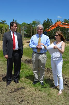 From left, Greg Blower of Senator Kenneth P. Lavalle's office, State Assemblyman Fred W. Thiele Jr. and Kim Erle, project leader and homeowner of Sunset Green Home, a LEED home project in East Quogue, NY.